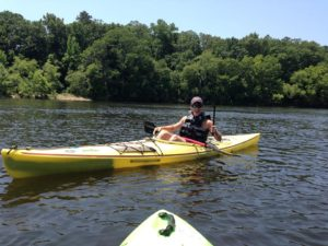 A wild kayak camper appears.. appears to be having a great time on the water!